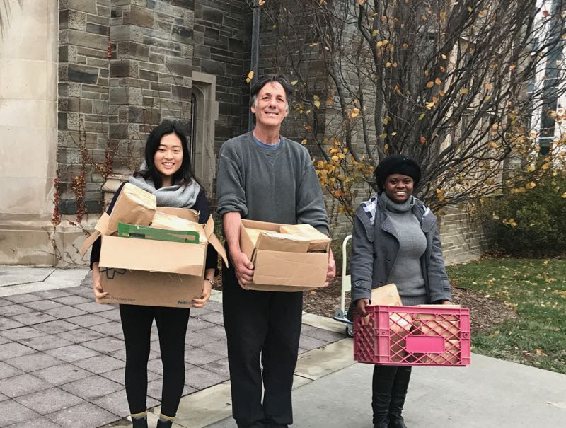Clara, Gary, and Yvette bringing books to the post office on #givingtuesday after receiving over $700 in donations. :-)