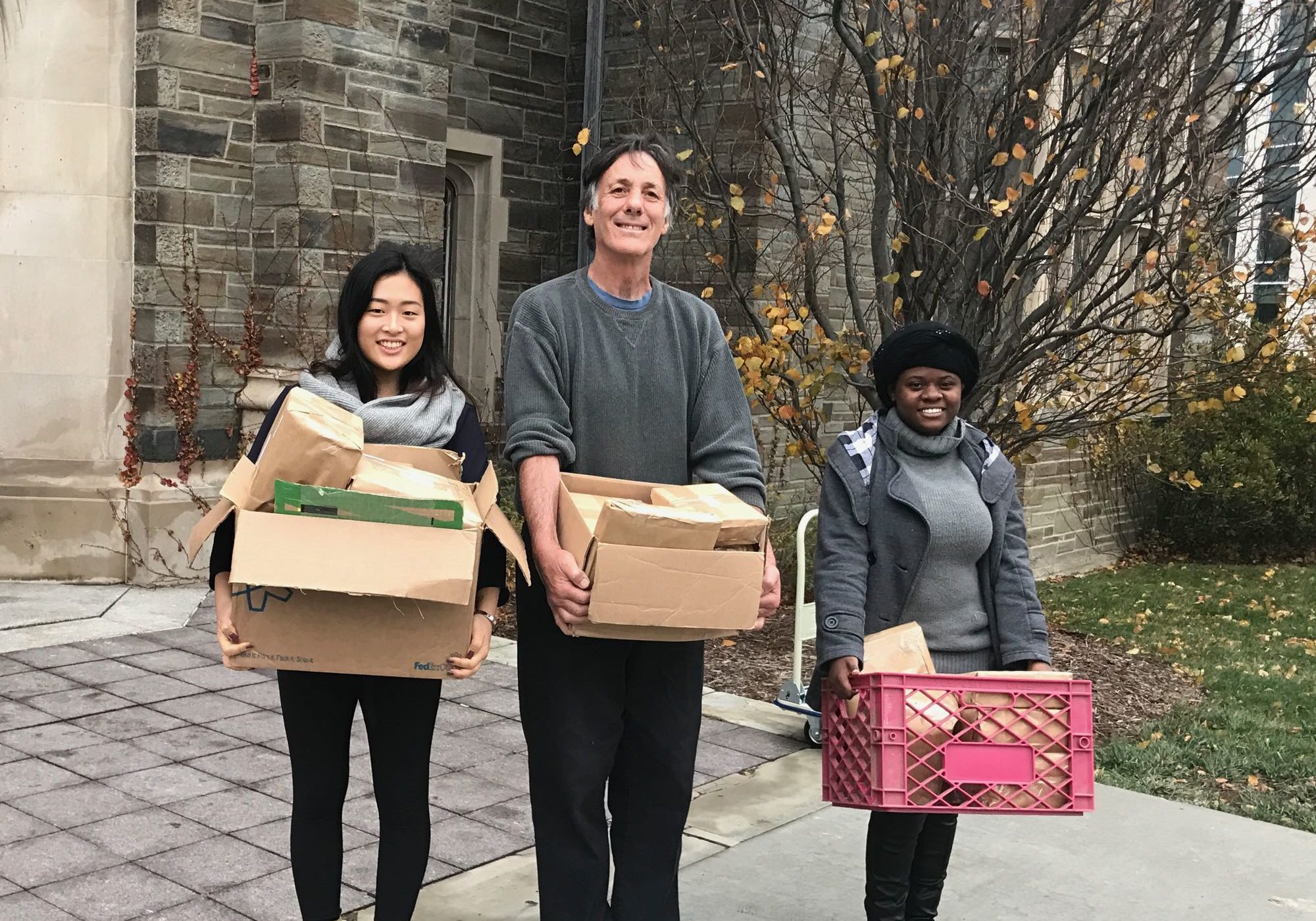 Clara, Gary, Yvette bringing packages to the post office